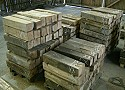 Reclaimed oak beams sawn up for cabinet-makers/carpenters